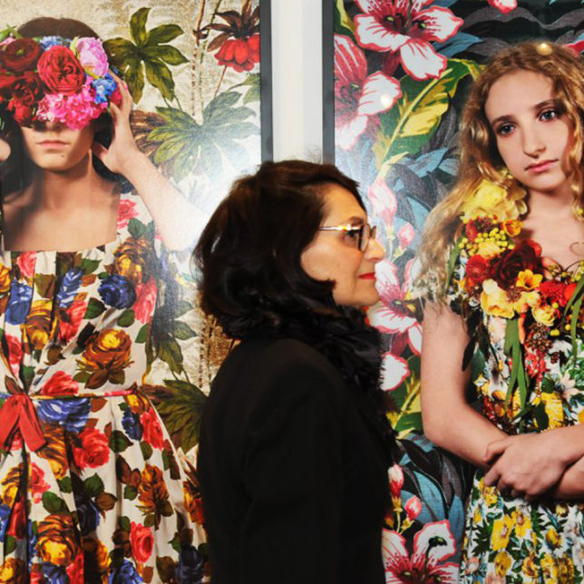 A guest passes by the work of Polixeni Papapetrou Chandri Barat (guest). c/o Paul Robeson Galleries