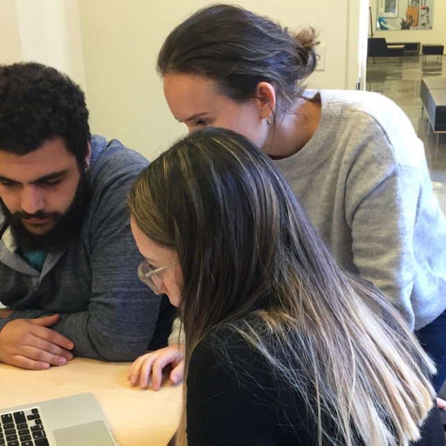 Professor Chantal Fischzang working with students Cindy Gizman & Abraam Tawkif, on the new LGBT RAIN Foundation brand identity system. c/o Design Consortium