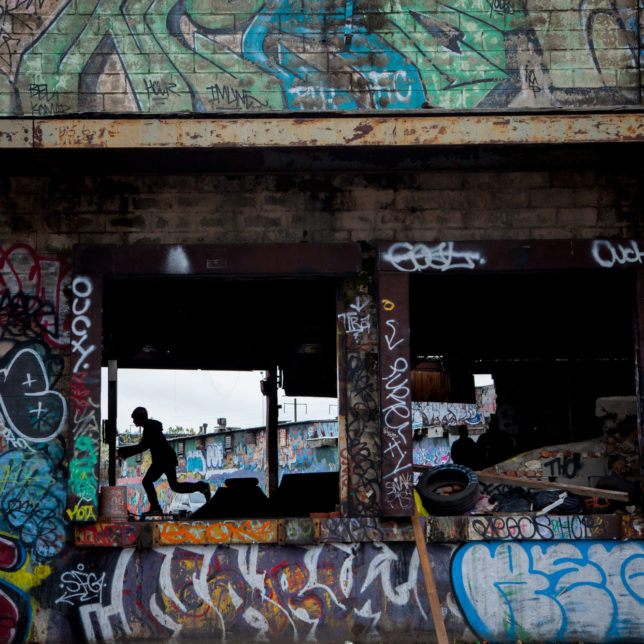 Local teens skate in an abandoned warehouse-turned-skatepark on Avenue C in Newark. c/o Ashley Gilbertson