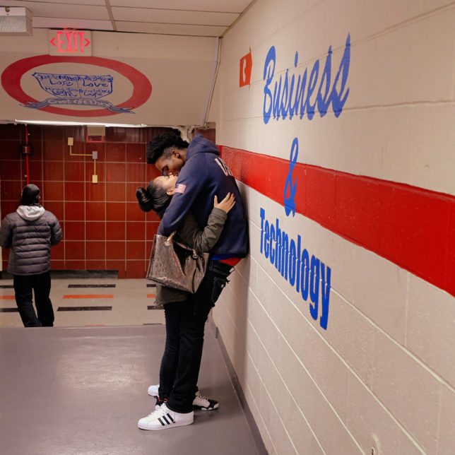 A couple at East Side High School embrace for a kiss between classes. c/o Ruddy Roye