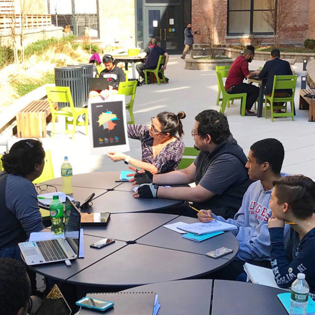 Co-Director Jennifer Bernstein and students Alan Weingast, Francisco Pena, Ronaldo Spooner, Nadya Andrianova, and Alexandra Pozo meet in the Express Newark Courtyard. c/o Visual Means