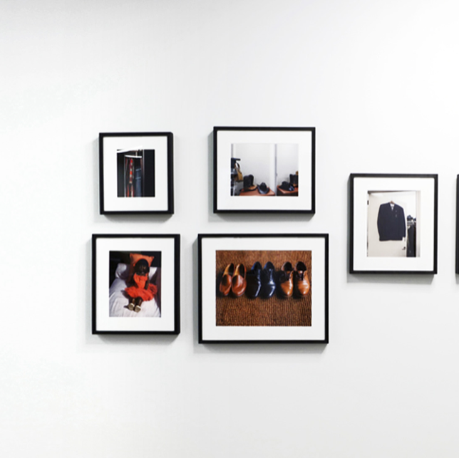 Gallery of images on a white wall
