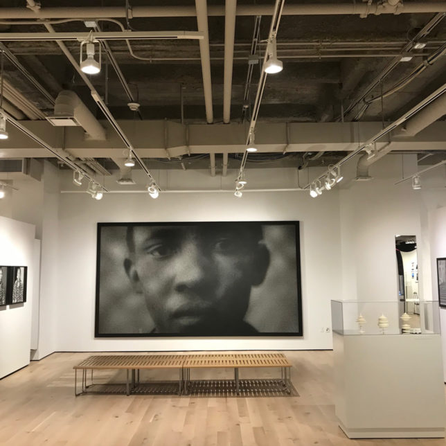 "Anne-Karin Furunes' ""Of Faces X (Portraits of Archive Pictures)"" 2016, acrylic on canvas, perforated on installation in ""Mirror Mirror."" Courtesy of the artist and RYAN LEE Gallery, New York. c/o Paul Robeson Galleries"