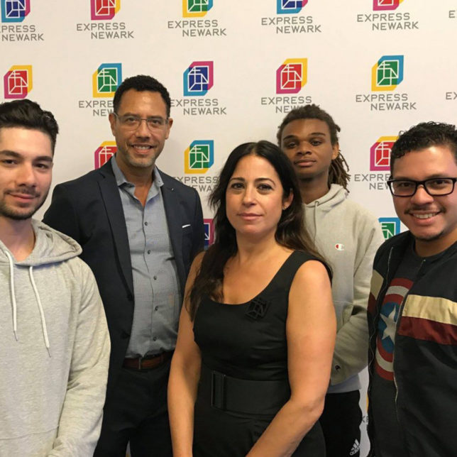 Visual Means student designers and project leadership (From left to right): Kevin Cristancho, Professor of Law and CLiME Director David Troutt, Graphic Design Professor and Visual Means Co-Director Jennifer Bernstein, Tyren Crowley, and Cristopher Sanchez. c/o Anthony Alvarez