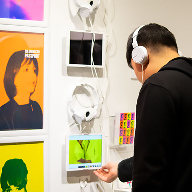 Pictured: someone interacting with a multimedia installation at the 2019 Graphic Design Capstone Show. c/o Gustavo Morais