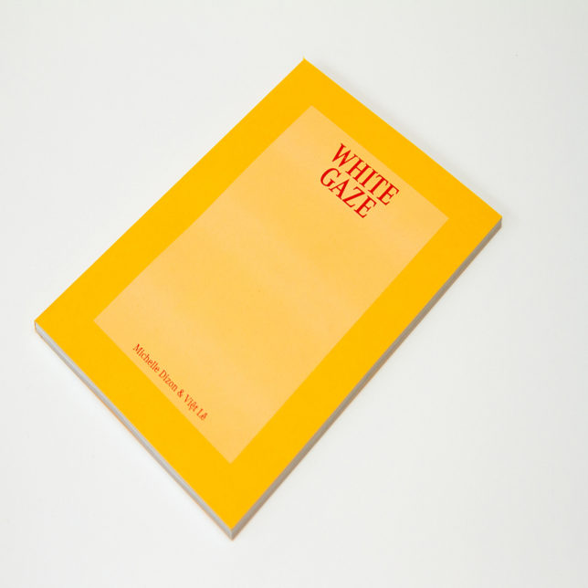 Yellow book with the words. White Gaze, on the cover in red