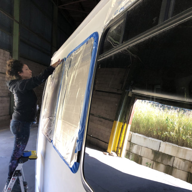Artist Gera and her crew paint the Story Bus. Photo: Julie Winokur