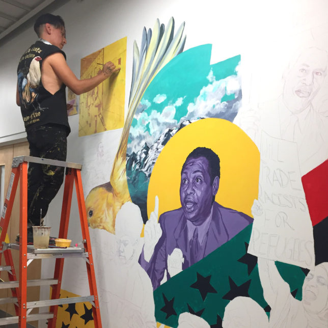 Artist Lenny Correa painting one of the 3 Robeson Murals.