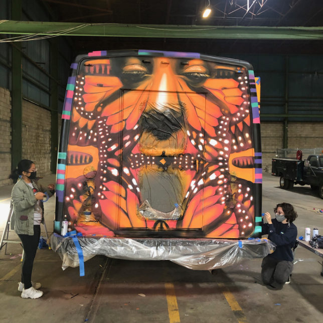 Artist Gera and Rutgers Students paint the Story Bus. Photo: Julie Winokur